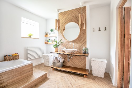 This picture shows a modern bathroom design with a wooden vanity.